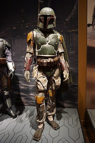 630025043_320px-Star_Wars_and_the_Power_of_Costume_July_2018_28_(Boba_Fetts_costume_helmet_and_jetpack_from_Episode_VI).jpg.3b8842509d3229d6af37b481ebf36ecc.jpg
